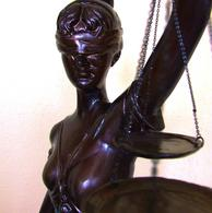 "<img src=""https://www.touslaw.com/justice.jpg"" alt=""lady justice"" />"