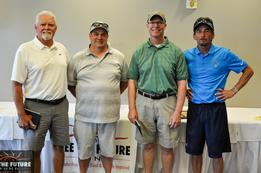 Picture of 2nd place foursome - standing, smiling at camera