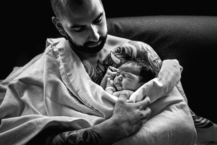 Birth photographer Jennifer Strilchuk captures dad holding newborn daughter at Langley Hospital