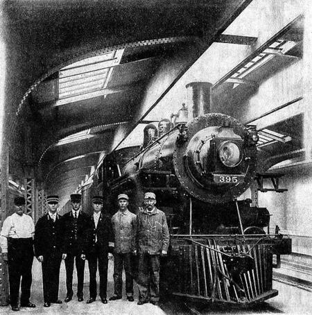 The first North Western train and its crew to depart Chicago and North Western Terminal which was completed by the railroad in 1911.