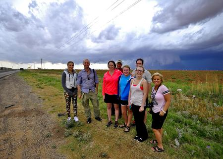 Tornado Tours Wall Cloud behind guests
