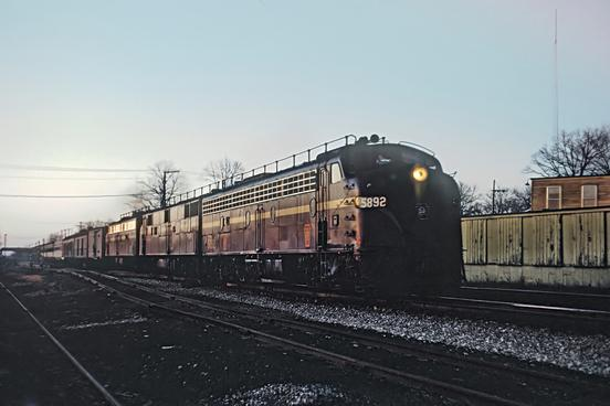 PRR E8A No. 5892 with Eastbound Train No. 48, The General, through Valpariso, IN at sunset on November 26, 1965. Photo by Roger Puta.