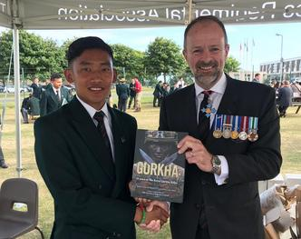 Craig Lawrence author of the new Gurkha RGR25 book with Rifleman Ekbahadur Gurung whose face is on the cover