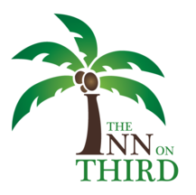picture of the inn's official logo. A palmtree, with the trunk representing the I in the word inn