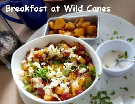 A plate of eggs poached in a nest of cabbage, potatoes, peppers and bacon. All Inclusive Vacation Packages include meals from our on site restaurant Wild Canes.