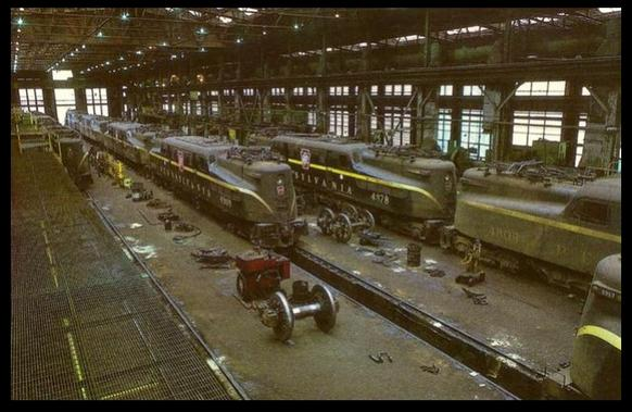 A postcard photo of Pennsylvania Railroad GG-1's at the Pennsylvania Railroad main electric shop at Wilmington, Delaware in October of 1967.