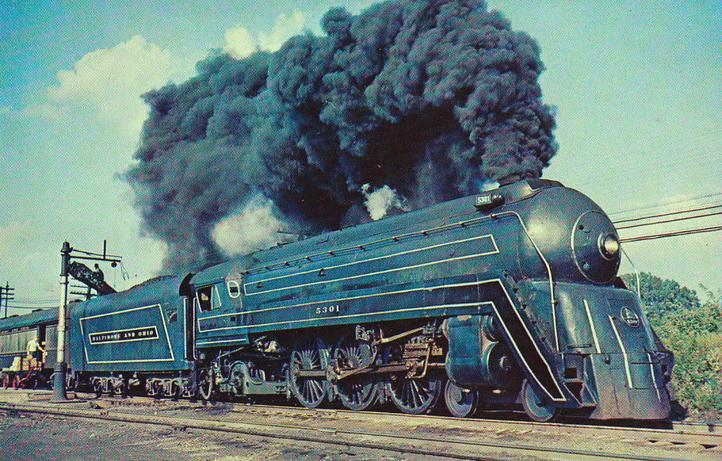"The B&O's Cincinattian led by No. 5301, ""The President Adams"", a streamlined 4-6-2 Pacific style locomotive, July 1956."