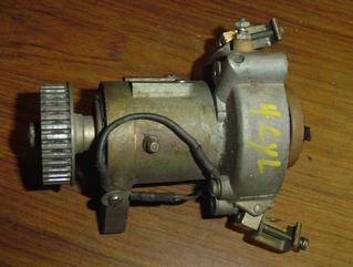 Used complete distributor with points, rotor, pulley, etc. for Chrysler 4 cylinder outboards FA440309