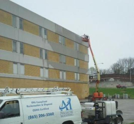 A1 Pressure Washing soft washing the EIFS of a hotel pressure washing