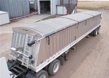 Shur-Co 4500 electric side roll tarp system on a grain trailer.