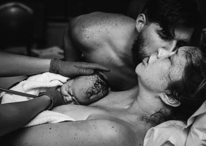 Intimate moment captured during Birth Photography at Langley Hospital Birth