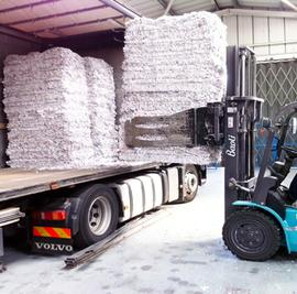 Shredded Paper Being Loaded onto a Truck By Forklift
