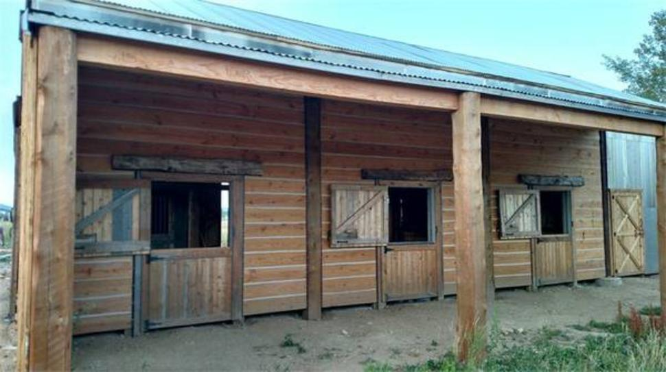 Ol Western Style Row Horse barn with Dutch Doors