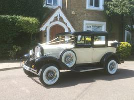 Badsworth Landaulette Vintage style Saloon wedding car in black and white - Essex Wedding Cars