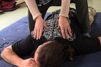 person receiving bodywork therapy