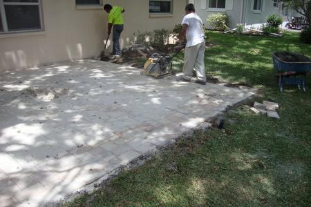 How to Seat Pavers with sand and compactor