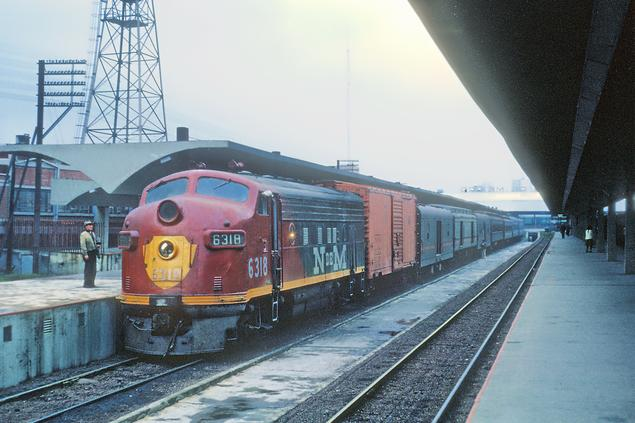 N de M Train No. 61 for Beristain led by F unit No. 6318 at Buenavista Grand Central Station, Mexico City, D.F., Mexico on September 11, 1966. Photo by Roger Puta.