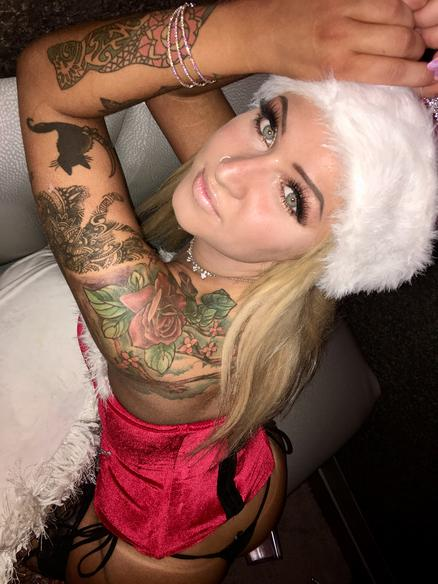 woman with tattoos and fur jacket