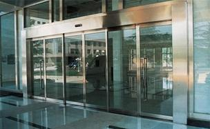 Automatic sliding power door operator