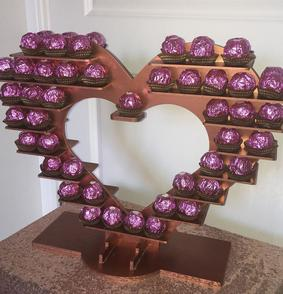 "alt=""ferrero rocher stand hire sweet dreams candy cart"""