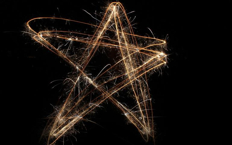 star woven of sparkly twine against black background