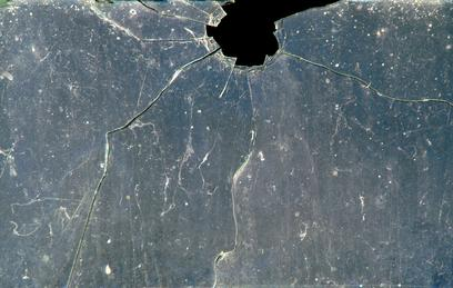 Glass broken by projectile