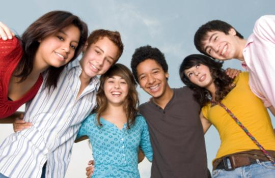 junior high kids smiling in group
