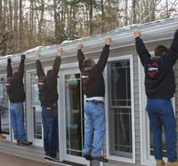Our experts performing gutter repair services in Brunswick, ME