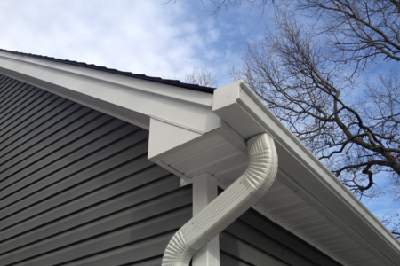 repaired gutter system on home