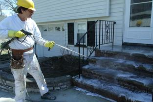 technician using pressure washer