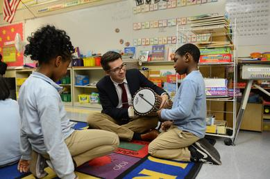 Rider students teach children drumming.