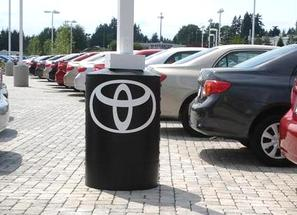Light pole base cover with dealership logo.