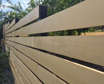 Alaskan Yellow Cedar boards installed vertically for a beautiful fence