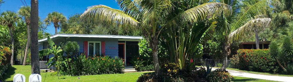 A lush private yard at the Blue Lagoon vacation bungalow on Siesta Key.