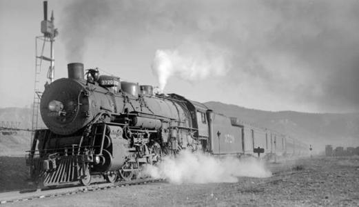 Train No. 9, The Navajo; 7 cars, 25 MPH. Photographed: leaving Raton, N.M., April 9, 1939.