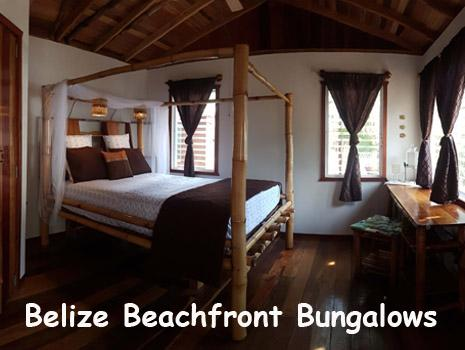 The interior of a bungalow with queen sized bed and private bathroom. Steps from the Caribbean Sea. Belize Beach Vacations