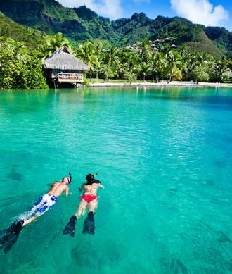 Luxury Crewed Yacht Charters French Polynesia Couple Snorkels In Bay Big Blue Yacht Charters