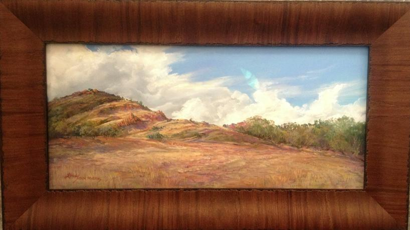 Breaking the Drought, a plein air pastel by Lindy Cook Severns custom framed under non-reflective museum glass. Framing by Midland Framing, Midland TX
