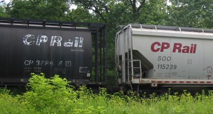 Reporting marks on two CP covered hopper cars; with the left car marked as CP 388686 and the right car marked as SOO 115239.