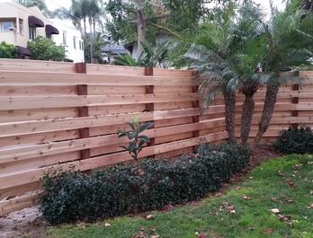 Western Red Cedar Decking used as vertical fencing