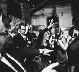 wedding dance party hands in the air