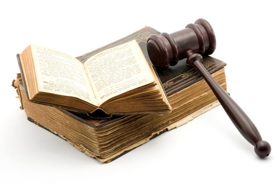 Ancient law books and gavel