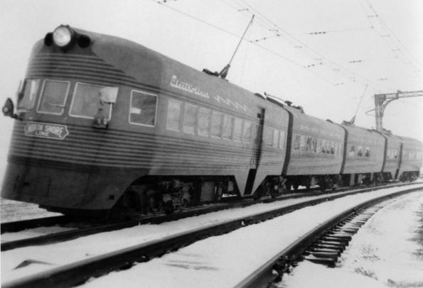 "The Chicago, North Shore and Milwaukee Railway's ""Electro-Liner"" enroute between Chicago and Milwaukee on a winter day in February 1941. [""Electro-Liner"" between Milwaukee and Chicago], photograph, February 1941; (texashistory.unt.edu/ark:/67531/metapth28717/m1/1/?q=railroad: accessed July 4, 2016), University of North Texas Libraries, The Portal to Texas History, texashistory.unt.edu; crediting Museum of the American Railroad."