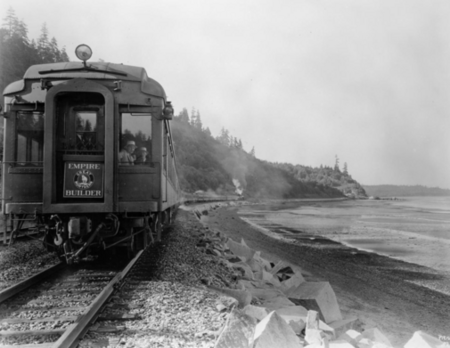 "Great Northern Railway's ""Empire Builder"" train No. 31, westbound, traverses the route along Puget Sound, nearing Seattle, 1929."