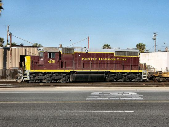 Former B&O No. 2401, an SD20-2 rebuild, works the Pacific Harbor Line in Long Beach, California in February, 2005.