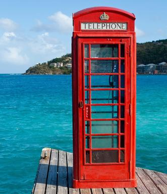 Luxury Crewed Charter Yachts British Red Phone Box on Dock British Virgin Islands Big Blue Yacht Charters