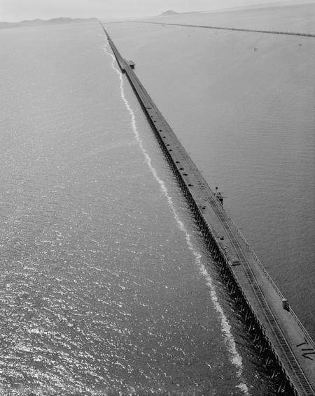 Aerial view of the Lucin Cutoff trestle before removal. The 1950s causeway can be seen to the right of the trestle.