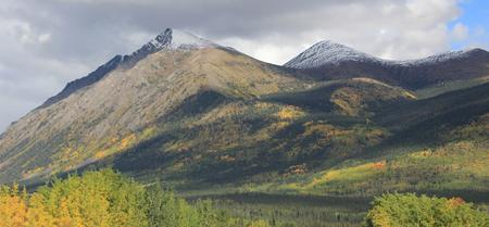 The town of Carcross, Yukon sits in a valley surrounded by mountains on all sides.