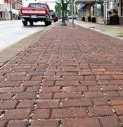 Eco-friendly permeable driveway paver Eco-optiloc by Unilock at commercial property