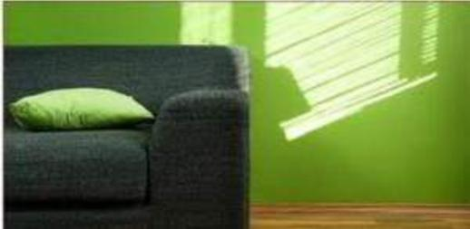 Green painted walls in room with couch.